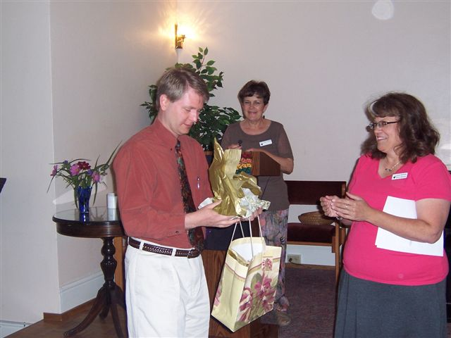 Rev. Joe receiving farewell gift.